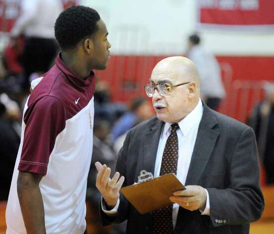 St. Joseph basketball coach Vito Montelli, right, talks to his player Timajh Parker during boys high school basketball game between Greenwich High School and St. Joseph of Trumbull at Greenwich on Wednesday, Feb. 15. Photo: Bob Luckey, Bob Luckey/Staff Photographer / Greenwich Time