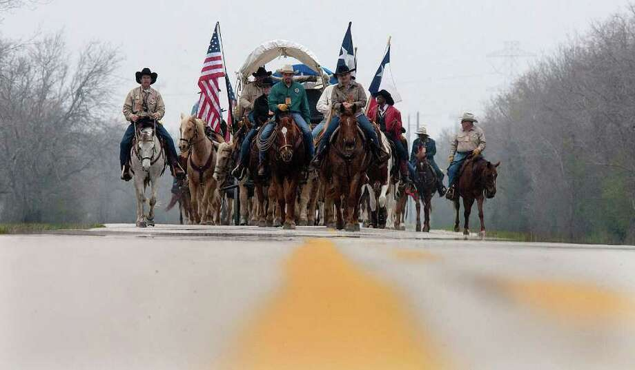 The Valley Lodge trail riders, from Brookshire, make their way down Barker Cypress Rd. on their 71 mile journey to Houston, Thursday, Feb. 23, 2012. The group, which has 100 riders, was established in 1959. Photo: Johnny Hanson, Houston Chronicle / © 2012  Houston Chronicle