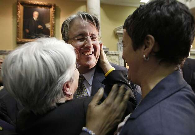 Sen. Richard Madaleno, D-Montgomery, center, hugs Rep. Maggie McIntosh, D-Baltimore City, left, and Rep. Heather Mizeur, D-Montgomery, fellow openly gay members of the Maryland General Assembly, in Annapolis, Md., Thursday, Feb. 23, 2012, after the Senate approved a gay marriage bill. Photo: Patrick Semansky, Associated Press