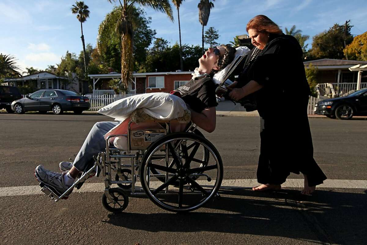 Madelyn Bennett shares a moment with her son John Gibson while on a walk around their neighborhood in San Diego on Friday March 11, 2011. Gibson suffered a heart attack while at UC Berkeley after ingesting illicit drugs and is now in a minimally conscious state.