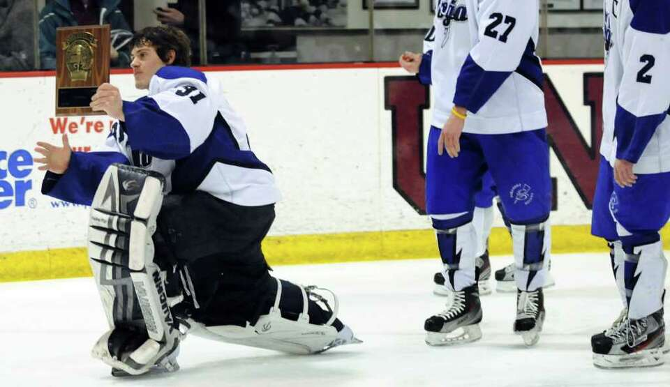 Saratoga's goalie Ryan Bourgeois (31) plays to the fans as the team takes a victory lap with the pla