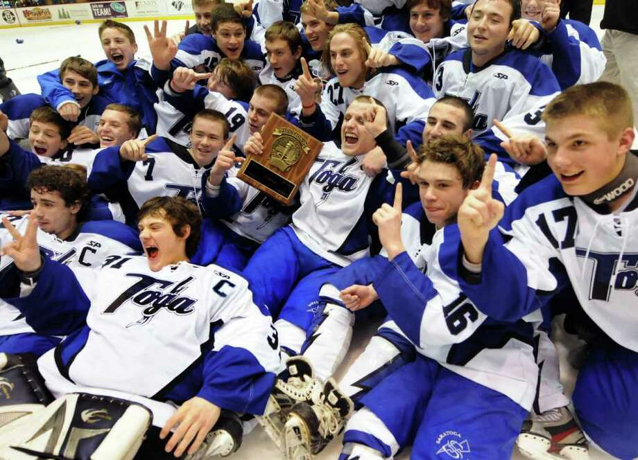 Saratoga poses with the plaque as they celebrate their win 5-1 over Shenendehowa for the Section II hockey title on Thursday, Feb. 23, 2012, at Union College in Schenectady, N.Y. (Cindy Schultz / Times Union) Photo: Cindy Schultz / 00016550A