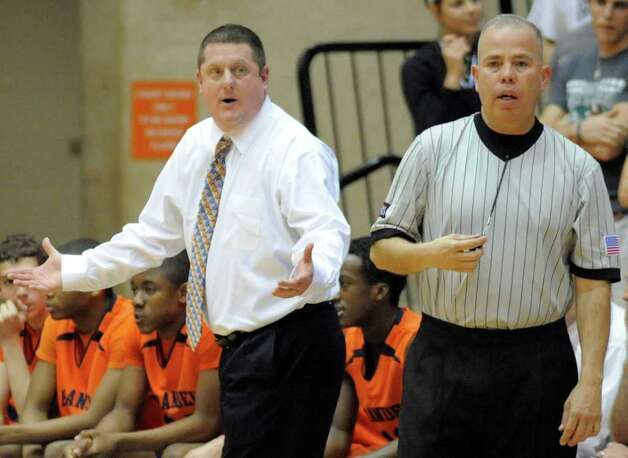 Brandeis head coach Marc Gardner, left, argues a call with the referee during a high school basketball playoff game against Reagan, Thursday, Feb. 23, 2012, at UTSA in San Antonio. Brandeis won 52-43. Photo: Darren Abate, Express-News