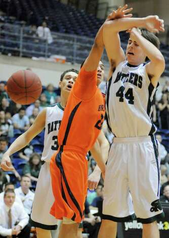 Reagan's D.J. MacLeay, right, collides with Brandeis' Jeremy Martinez during a high school basketball playoff game, Thursday, Feb. 23, 2012, at UTSA in San Antonio. Brandeis won 52-43. Photo: Darren Abate, Express-News