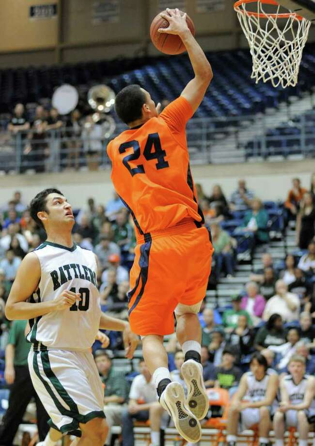 Brandeis' Jeremy Martinez, right, shoots over Reagan's Bryan Hardy during a high school basketball playoff game, Thursday, Feb. 23, 2012, at UTSA in San Antonio. Brandeis won 52-43. Photo: Darren Abate, Express-News