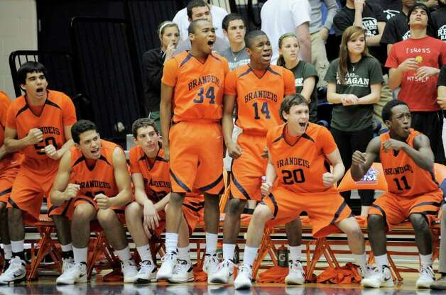 The Brandeis bench cheers during a high school basketball playoff game against Reagan, Thursday, Feb. 23, 2012, at UTSA in San Antonio. Brandeis won 52-43. Photo: Darren Abate, Express-News