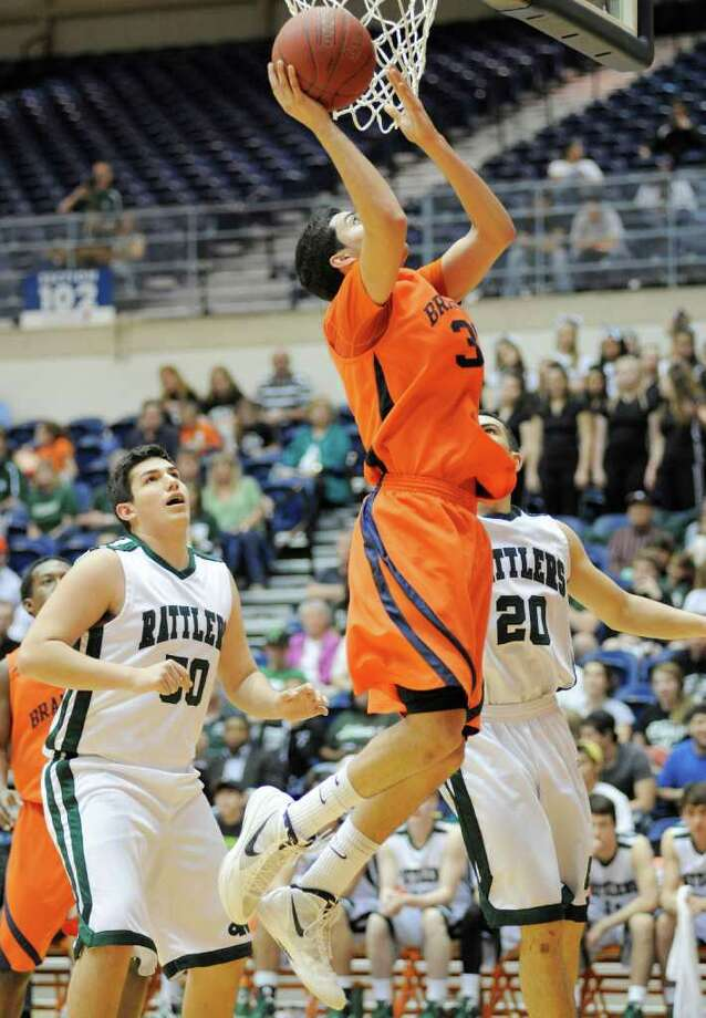 Brandeis' Matt Kallead, right, shoots over Reagan's Jordan Alvarado during a high school basketball playoff game, Thursday, Feb. 23, 2012, at UTSA in San Antonio. Brandeis won 52-43. Photo: Darren Abate, Express-News