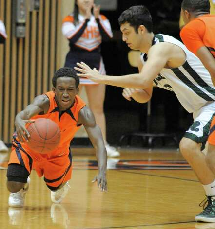Brandeis' Chris Starkes, left, and Reagan's Bryan Hardy dive for a loose ball during a high school basketball playoff game, Thursday, Feb. 23, 2012, at UTSA in San Antonio. Brandeis won 52-43. Photo: Darren Abate, Express-News