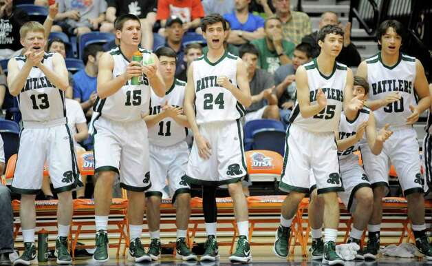 The Reagan bench cheers during a high school basketball playoff game against Brandeis, Thursday, Feb. 23, 2012, at UTSA in San Antonio. Brandeis won 52-43. Photo: Darren Abate, Express-News