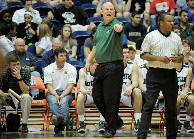 Reagan head coach John Hirst yells to his players during a high school basketball playoff game against Brandeis, Thursday, Feb. 23, 2012, at UTSA in San Antonio. Brandeis won 52-43. Photo: Darren Abate, Express-News