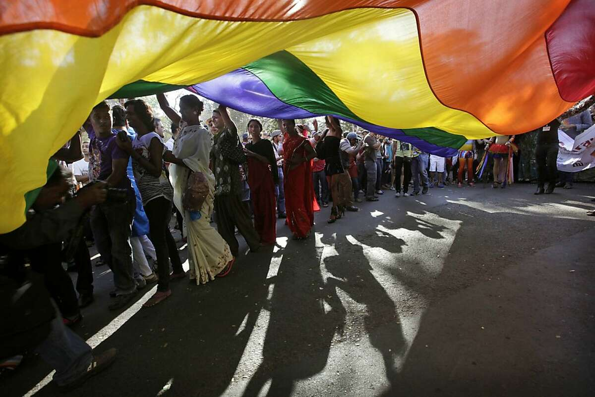 In this Jan. 28, 2012 file photo, participants carry a rainbow flag during a gay, lesbian, bisexual and transgender parade in Mumbai, India. A lawyer for India's Home Ministry told the country's top court Thursday, Feb. 23, 2012, that gay sex was