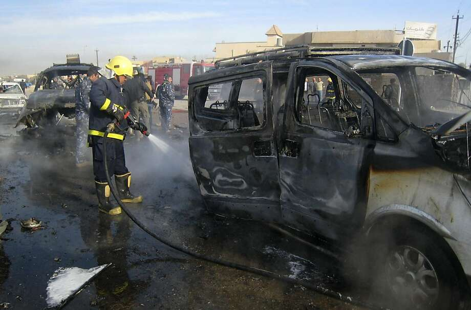 An Iraqi firefighter hoses down a burned bus after a car bomb attack in Kirkuk, 290 kilometers (180 miles) north of Baghdad, Iraq, Thursday, Feb. 23, 2012. A rapid series of attacks spread over a wide swath of Iraqi territory killed and injured dozens of Iraqis on Thursday, targeting mostly security forces. Photo: Emad Matti, Associated Press