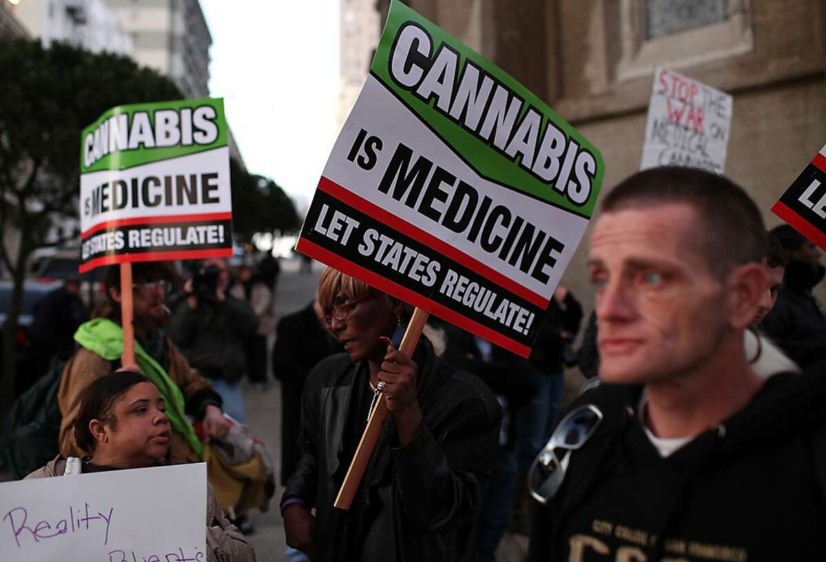 Medical marijuana advocates hold signs as they demonstrate outside the site where U.S. President Barack Obama was holding a fundraiser on February 16, 2012 in San Francisco, California. Dozens of medical marijuana advocates joined anti-Obama protestors outside of a fundraiser at the Nob Hill Masonic Center.