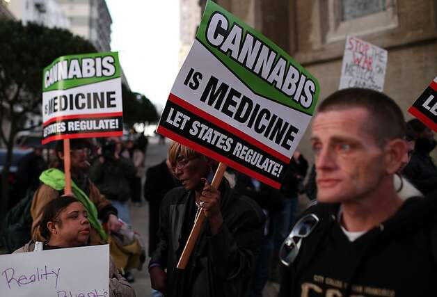 Medical marijuana advocates hold signs as they demonstrate outside the site where U.S. President Barack Obama was holding a fundraiser on February 16, 2012 in San Francisco, California. Dozens of medical marijuana advocates joined anti-Obama protestors outside of a fundraiser at the Nob Hill Masonic Center. Photo: Justin Sullivan, Getty Images