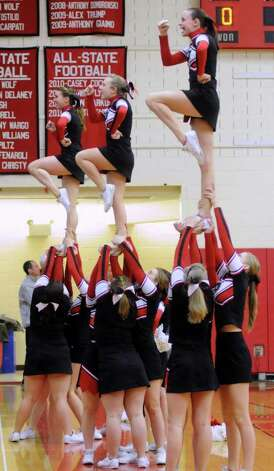 Pomperaugs cheerleaders cheer for their team during the South-West Conference girls basketball tournament finals on Thursday evening Feb. 23, 2012 at Masuk High School in Monroe. Photo: Lisa Weir / The News-Times Freelance