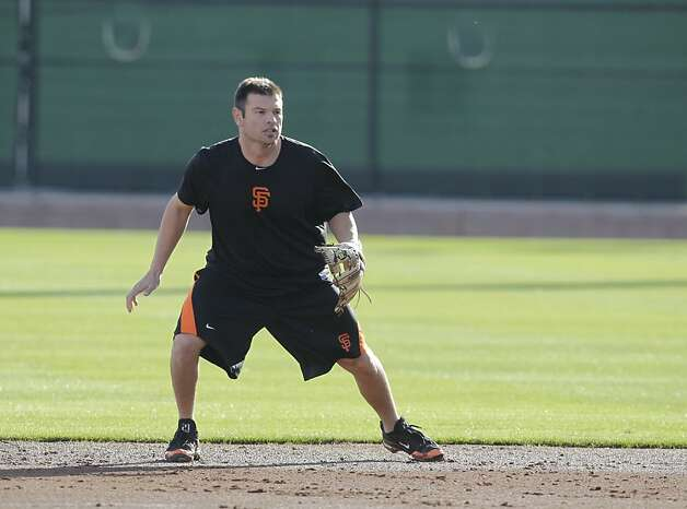 San Francisco Giants' Freddy Sanchez fields a ground ball during a spring training baseball workout Wednesday, Feb. 22, 2012, in Scottsdale, Ariz. (AP Photo/Darron Cummings) Photo: Darron Cummings, Associated Press
