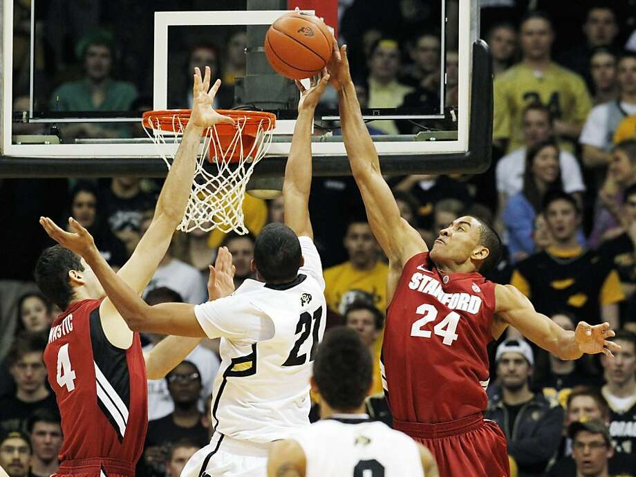 Stanford forward Josh Huestis, right, reaches up to block a shot by Colorado forward Andre Roberson, center, as Stanford center Stefan Nastic covers in the first half of an NCAA college basketball game in Boulder, Colo., Thursday, Feb. 23, 2012. (AP Photo/David Zalubowski) Photo: David Zalubowski, Associated Press