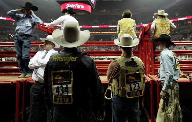 Cowboys wait to ride in the Saddle Bronc competition at the San Antonio Stock Show & Rodeo at the AT&T Center on Wednesday, Feb. 22, 2012. Photo: Jerry Lara, San Antonio Express-News / © San Antonio Express-News