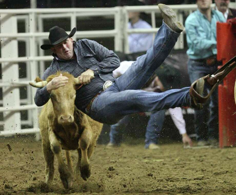 Shane Henderson, of Winfield, Kansas, scores a 4.3 in the Steer Wrestling competition at the San Antonio Stock Show & Rodeo at the AT&T Center on Wednesday, Feb. 22, 2012. Photo: Jerry Lara, San Antonio Express-News / © San Antonio Express-News