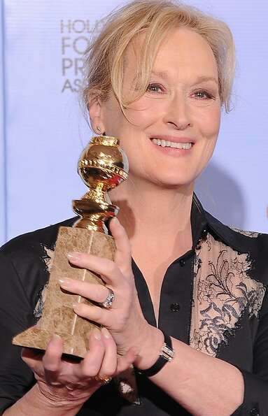 The winner for Best Performance by an Actress in a Motion Picture Drama Meryl Streep poses with the