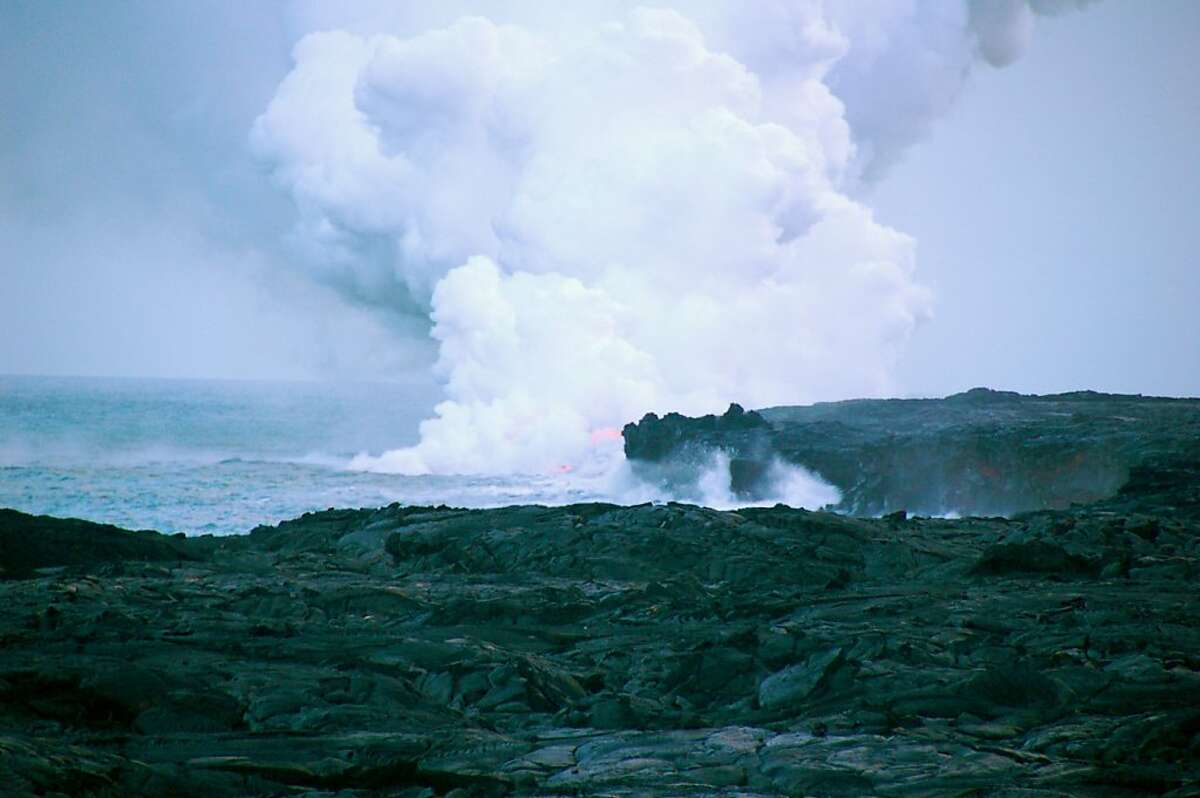 Lava entering the ocean creates a dramatic display but also many hazards for those who get too close, such as a steam plume containing minute lava fragments and acid droplets, and the possible collapse of the newly created lava bench.