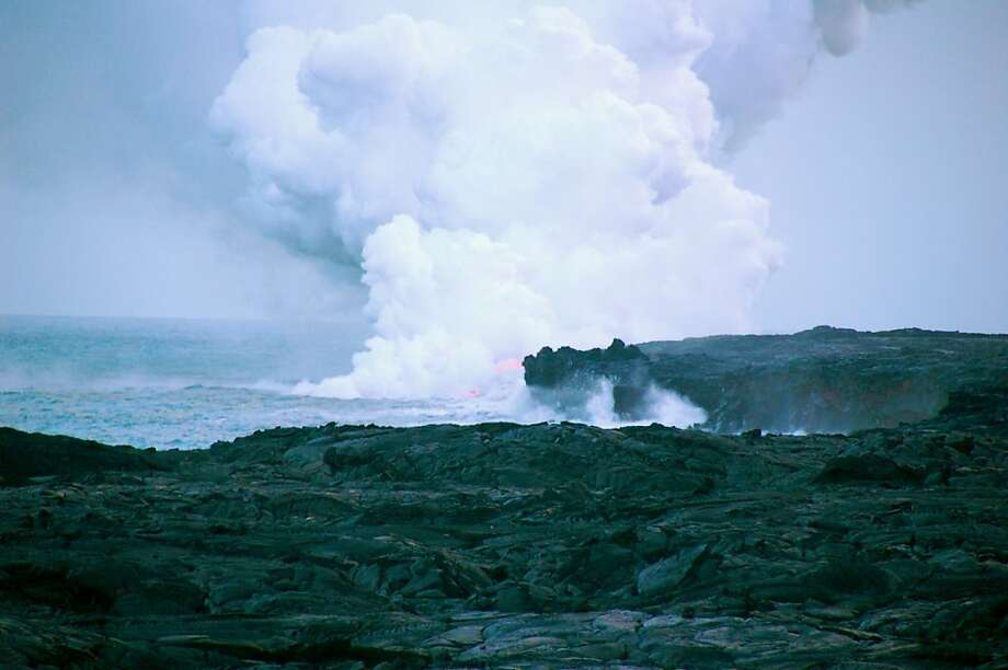 Lava entering the ocean creates a dramatic display   but also many hazards for those who get too close, such as a steam plume containing minute lava fragments and acid droplets, and the possible collapse of the newly created lava bench. Photo: Jeanne Cooper, Special To SFGate