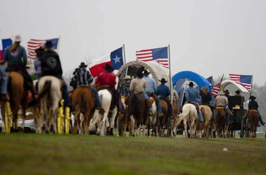 The Valley Lodge trail riders make their way down Westheimer Parkway through George Bush Park. (Johnny Hanson / Houston Chronicle)