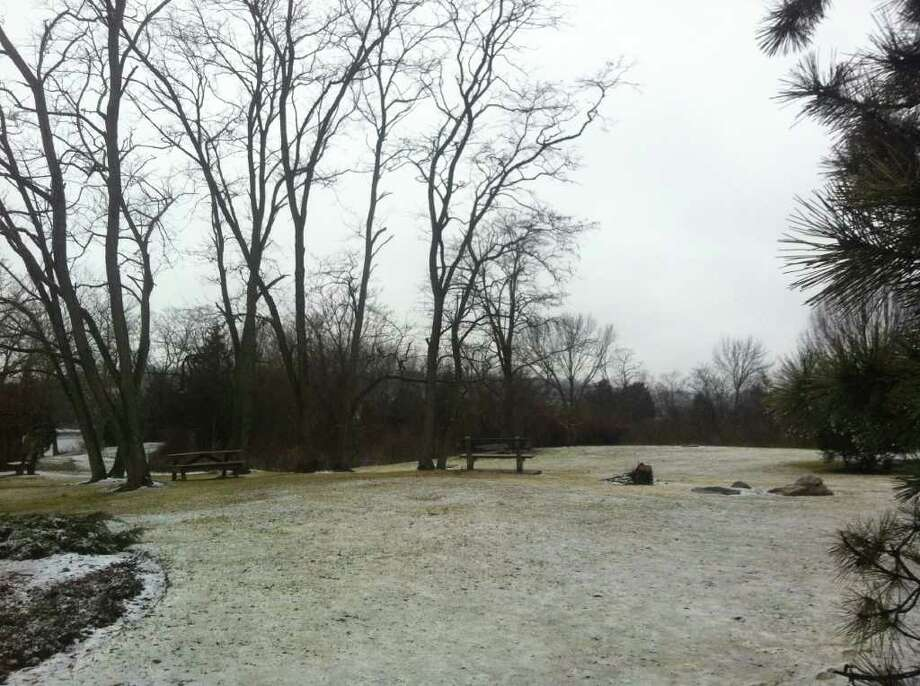 A light dusting of snow and sleet covers Grace K. Salmon Park, next to the Saugatuck River, early Friday in the wake of an overnight winter storm. Photo: Paul Schott / Westport News