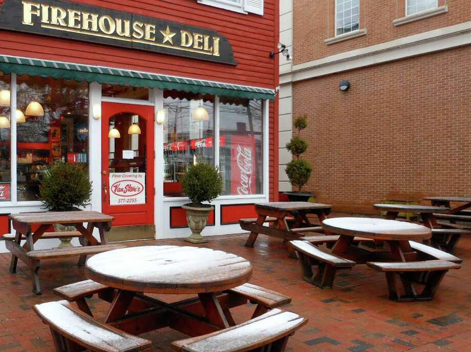 Light early-morning snow and sleet made outdoor seating Friday at the Firehouse Deli on Reef Road look a little less than appetizing. Photo: Mike Lauterborn / Fairfield Citizen contributed