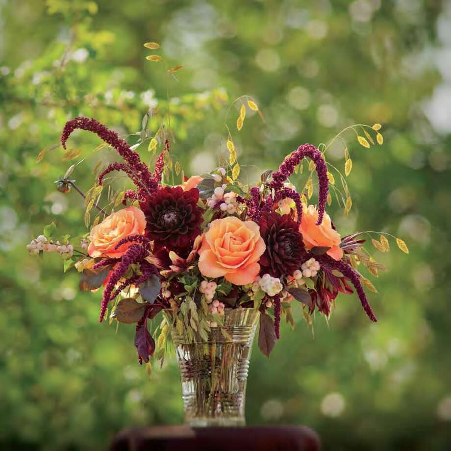 Dahlias, amaranth, roses and Northern sea oats create a peach-burgundy theme in Stacie Sutliff's floral arrangement in The 50 Mile Bouquet. Photo: David E. Perry