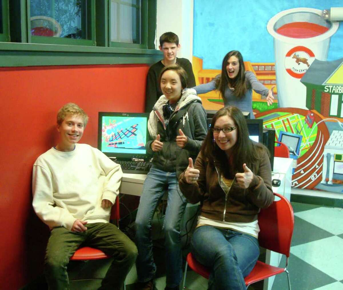 Outback Student Governing Board members pose by new computers donated by the Board of Education, from front left, Tim Casavant, Emily Serven, Outback Program Director Erin McDermott; back, James Shea and Outback Teen Coordinator Katelyn Sci.
