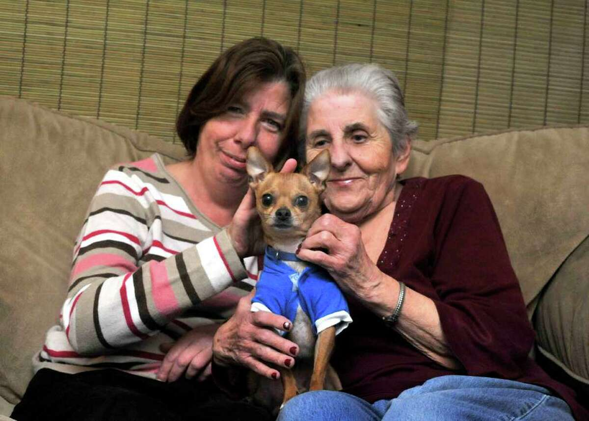 Jean Banks and her mother, Beverly, 77, hold Georgie in their Danbury condonium Friday, Feb. 24, 2012. The condo board has said Georgie cannot stay with the Banks.