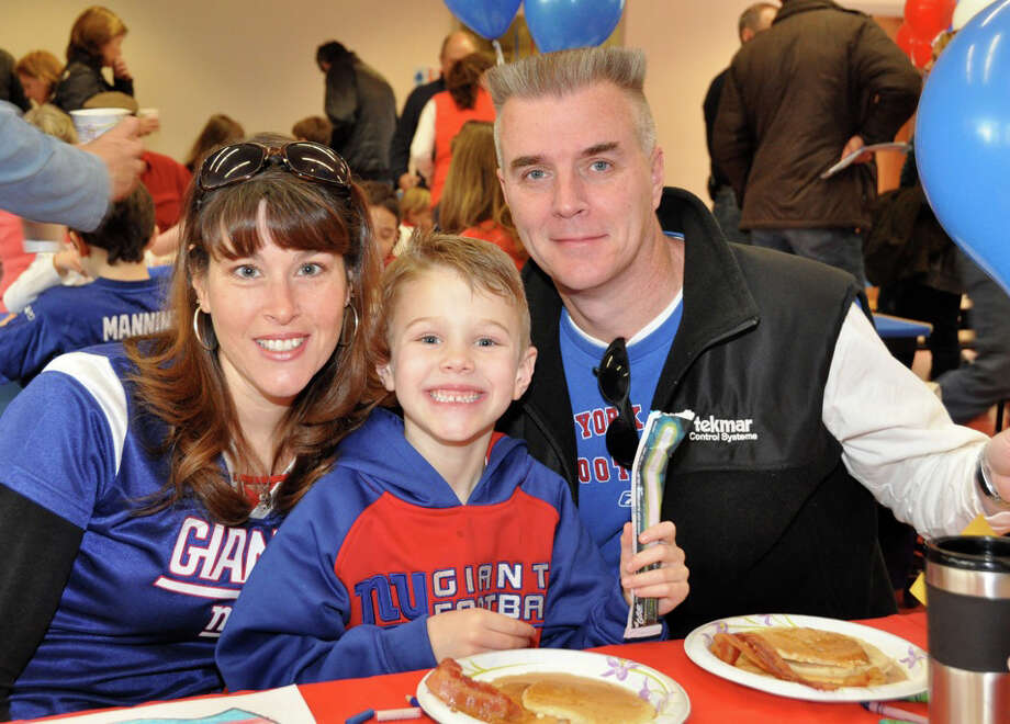 Pictured sporting their Giants gear are second grade teacher, Gail Smith, her son Ryan and husband Bob Smith. Photo: Contributed Photo