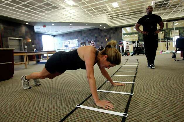 YOUR HEALTH:  KENS-TV anchorwoman Sarah Lucero works out during a boot camp class at Lifetime Fitness at The Rim on Friday Feb. 10, 2012.  Helen L. Montoya/San Antonio Express-News Photo: HELEN L. MONTOYA, San Antonio Express-News / ©2012 San Antonio Express-News
