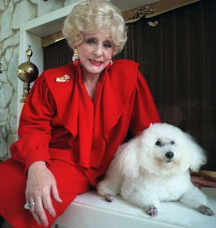 Mary Kay Ash poses with her poodle... 2544363 - SFGate
