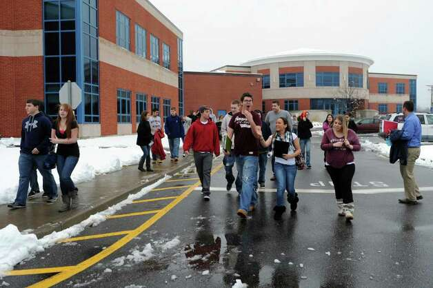 A chlorine leak forced the evacuation of students and staff at Seymour High School, in Seymour, Conn. Friday, Feb. 24th, 2012. The fumes were caused when some containers with chlorine became wet during a delivery earlier in the day. The evacuation followed a two-hour delay caused by a snow, and students were eventually sent home for the day. Photo: Autumn Driscoll / Connecticut Post