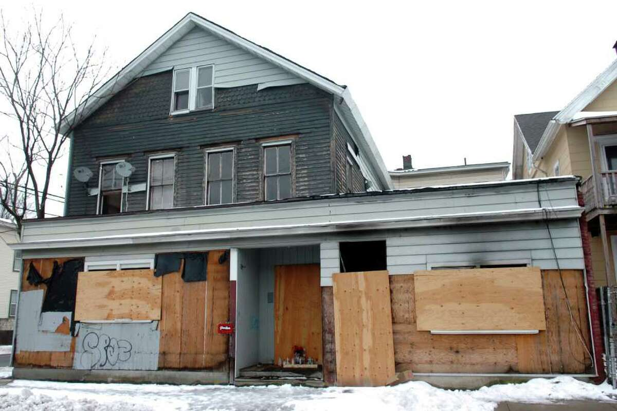 216 Brooks St., in Bridgeport, Conn. where a severely decomposed body was found last Friday. The death of the unidentified man found inside the abandoned building has been ruled a homicide, police said Monday.