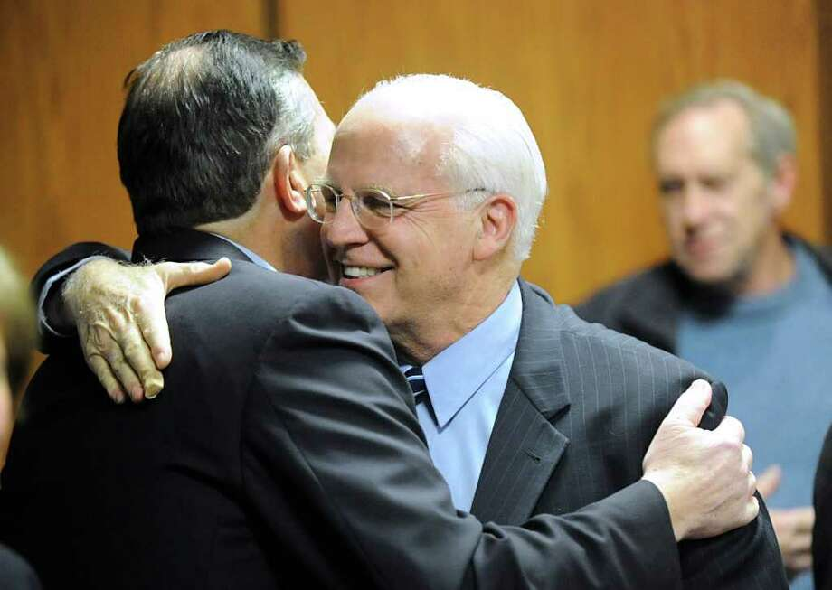 Greenwich Republican Ed Dadakis, left, hugs U.S. Senate hopeful Christopher Shays during the Republican Town Committee meeting at Greenwich Town Hall Feb. 22, 2012. Photo: Bob Luckey / Greenwich Time