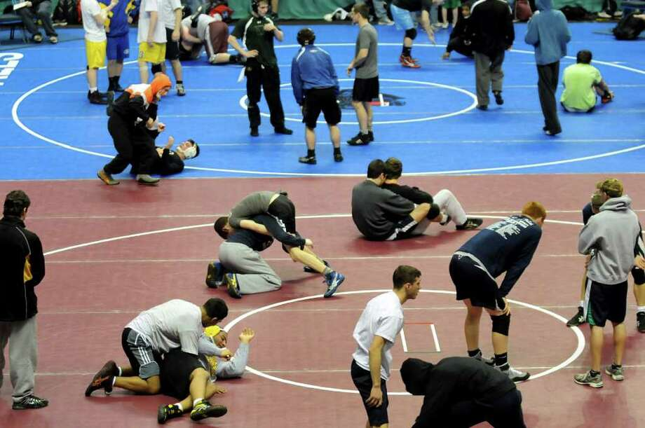 Wrestlers warm up during practice time on Thursday, Feb. 23, 2012, at Times Union Center in Albany, N.Y. The state wrestling tournament begins Friday. (Cindy Schultz / Times Union) Photo: Cindy Schultz / 00016531A