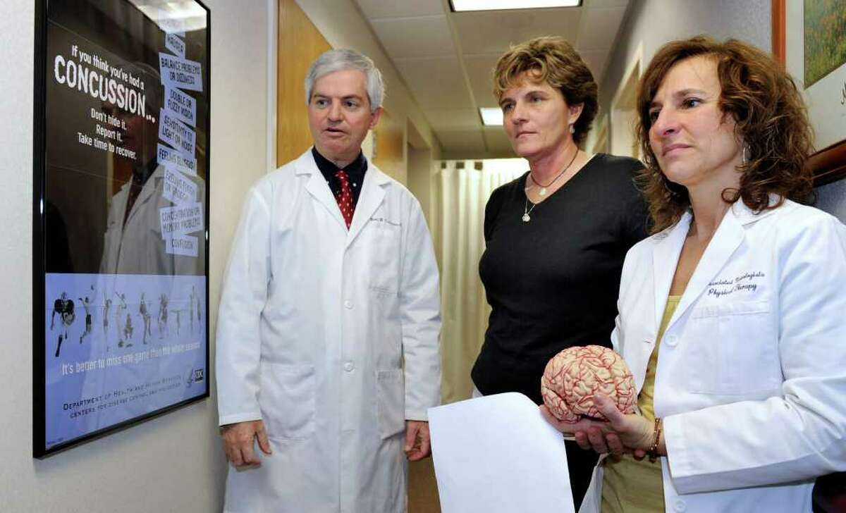 From left, Dr. Neil Culligan, neurologist, Karen Nell, a physical therapy assistant and varsity coach, and Dr. Lisa Dransfield, the physical therapy director at Associated Neurologist's, talk about a new Concussion Initiative Program. Photo taken Friday, Feb. 24, 2012.