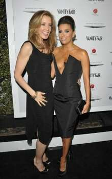 HOLLYWOOD, CA - FEBRUARY 23:  Actresses Felicity Huffman (L) and Eva Longoria attend the Vanity Fair and Chrysler celebration of The Eva Longoria Foundation hosted by Eva Longoria on Thursday, February 23 at Beso Hollywood.  (Photo by John Shearer/Getty Images for VF) (John Shearer / 2012 Getty Images)