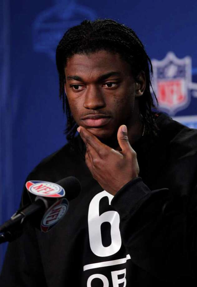 Baylor quarterback Robert Griffin III listens to a question during a news conference at the NFL football scouting combine in Indianapolis, Friday, Feb. 24, 2012. Photo: AP