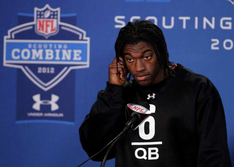 Baylor quarterback Robert Griffin III listens to a question during a news conference at the NFL foot