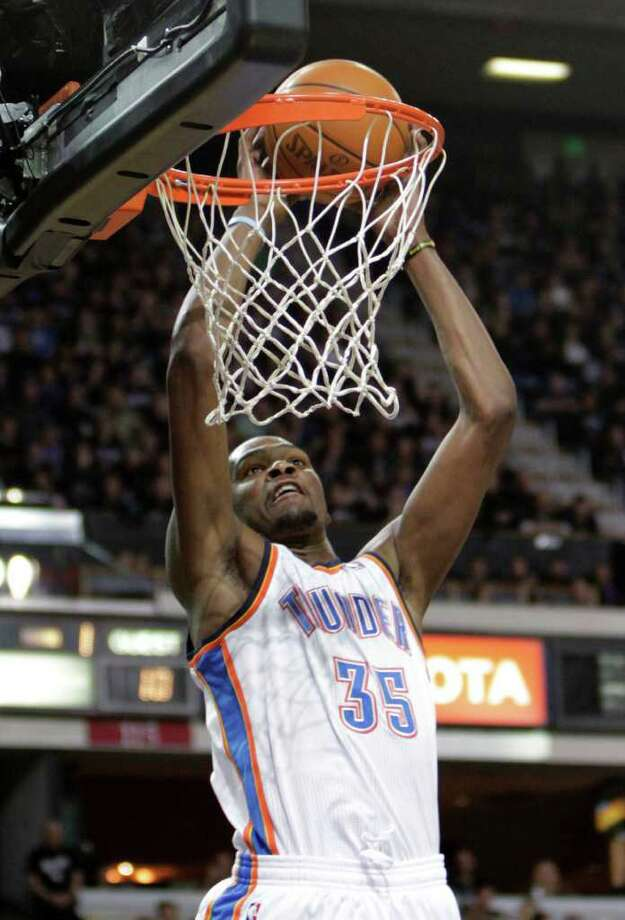 Thunder forward Kevin Durant says he's glad the All-Star Game gives him a chance to finally play alongside former Longhorn LaMarcus Aldridge. Photo: Rich Pedroncelli, Associated Press