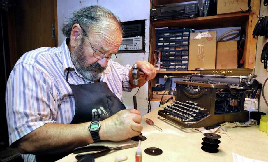 David Morrill, who runs American Typewriter and Amtype Repair Service in New Milford, works on restoring a 1936 LC Smith Secretarial office manual typewriter.  2010 file photo Photo: Carol Kaliff