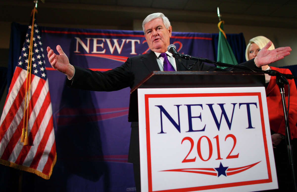 U.S. presidential candidate Newt Gingrich addresses supporters on a stage with his wife Callista during a rally at a hotel in Federal Way on Wednesday February 14, 2012. A room filled with supporters at the hotel greeted the former Speaker of the House.