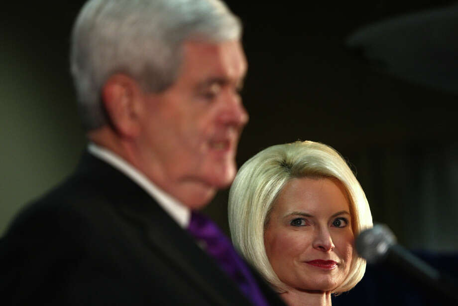 U.S. presidential candidate Newt Gingrich addresses supporters on a stage with his wife Callista during a rally at a hotel in Federal Way on Wednesday February 14, 2012. Callista Gingrich is in line to become the new U.S. Ambassador to the Vatican. She is the ex-Speaker's third wife, and is credited with playing a major role in his conversion to Catholicism. Photo: JOSHUA TRUJILLO / SEATTLEPI.COM