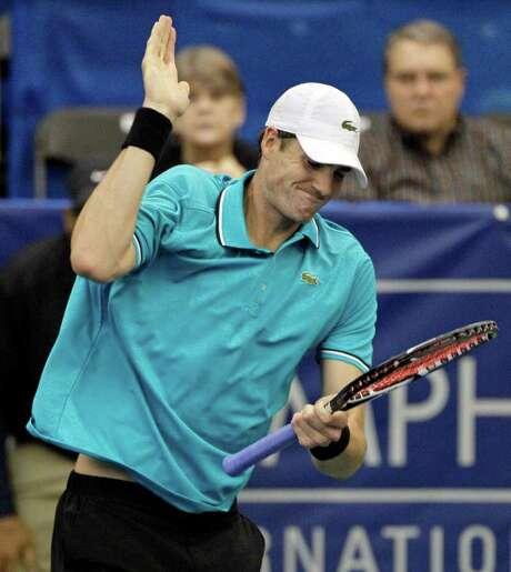 John Isner slaps his racket after losing a point to Jurgen Melzer at the Regions Morgan Keegan Championships. Photo: AP