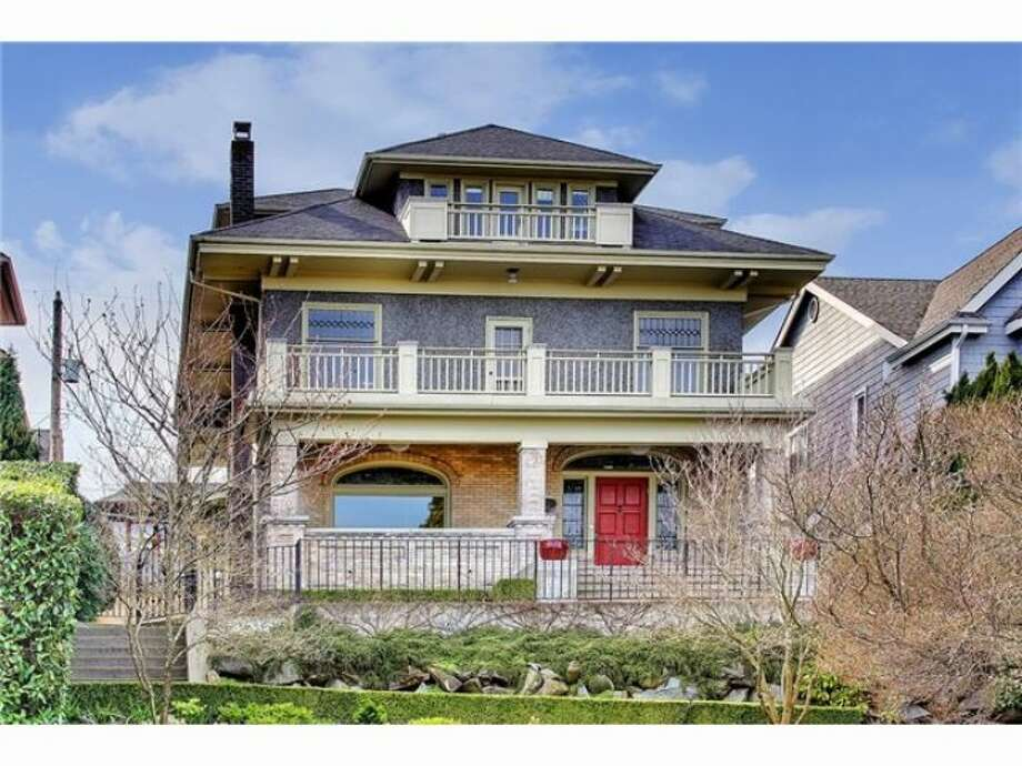 Here's a magnificent home in North Capitol Hill, at 939 18th Ave. E. The 5,634-square-foot house, built in 1907, has five bedrooms, four bathrooms, several bonus rooms, stained and leaded glass, French doors, built-in cabinets, a bar, a front porch and a back patio on a 6,000-square-foot lot. It's listed for $1.75 million. Photo: Heather Berger And Edward S. Krigsman, Windermere Real Estate