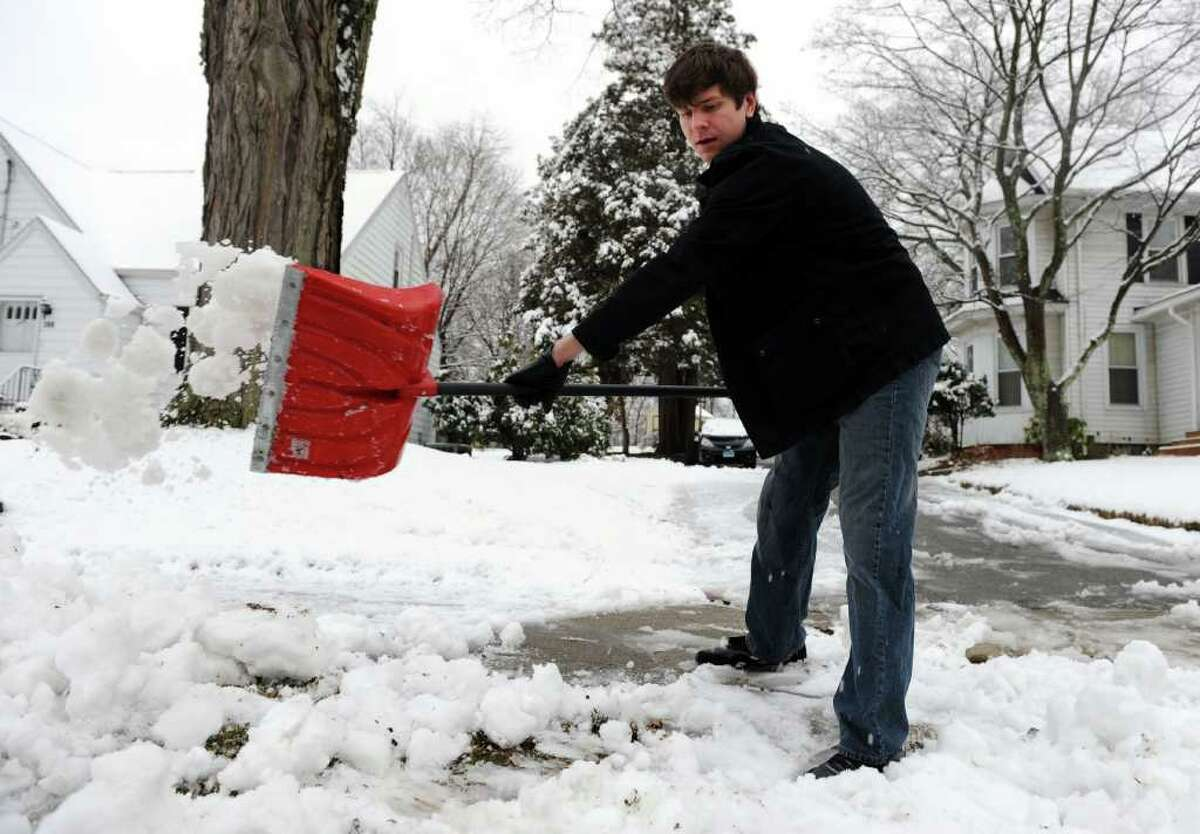 David Student clears snow from his driveway in Derby Friday, Feb. 24, 2012.